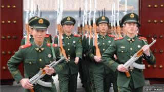Chinese paramilitary soldiers train outside their barracks in Beijing on 19 March 2012