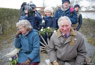Prince Charles and his entourage on a tractor trailer in Somerset