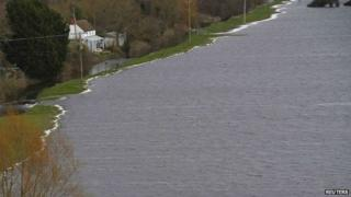 Floodwater is seen close to a house near Burrowbridge on the Somerset Levels