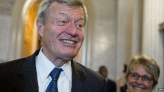 US Democratic Senator Max Baucus of Montana speaks with reporters alongside his wife, Melodee Hanes (right), after being confirmed by the US Senate as the next US Ambassador to China at the US Capitol in Washington, DC, 6 February 2014