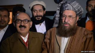 "Tehreek-e-Taliban Pakistan (TTP) committee member and senior religious party leader Maulana Sami-ul-Haq (R) shakes hands with Special Assistant to Pakistan""s prime minister Irfan Siddiqui after their meeting at the Khyber Pakhtunkhwa House in Islamabad on February 6, 2014."