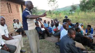 Residents of Kyarwehunde discuss the situation at a village meeting