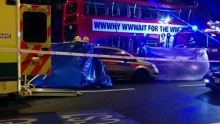 Officers work at crash scene