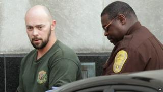 Robert Hoffman (left) is escorted from a court in Norfolk, Virginia. Photo: 6 December 2012