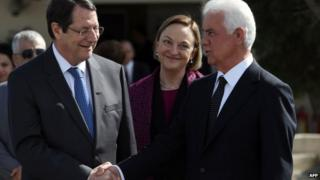Cypriot President Nicos Anastasiades shaking hands with Turkish Cypriot leader Dervis Eroglu