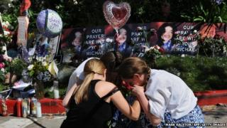 Fans grieve outside the rented Holmby Hills home of music legend Michael Jackson after his recent death, in Los Angeles on 29 June 2009.