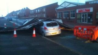 Two cars under metal sheeting at Barrow's Holker Street
