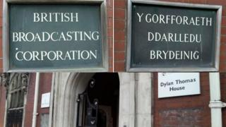 The two BBC signs outside the corporation's Swansea office and the holes in the wall left behind
