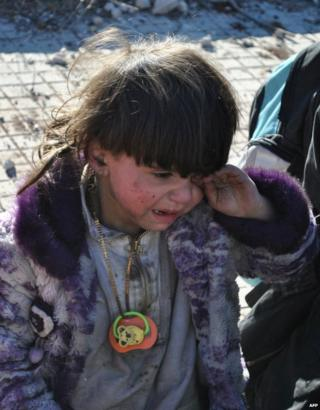 A child cries after being evacuated from the Old City of Homs, 12 February