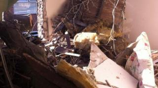 Room damaged by tree