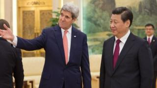 John Kerry (left) will discuss bilateral and regional issues with Xi Jinping