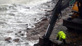 Man repairing slip way