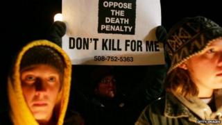 Anti-death penalty protestors hold signs in Enfield, Connecticut on Mary 13, 2005.