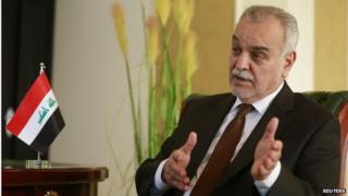 Iraq's former Vice President Tariq al-Hashemi gestures during a different interview in Doha on 26 January