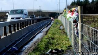 Flowers laid at the scene of the crash