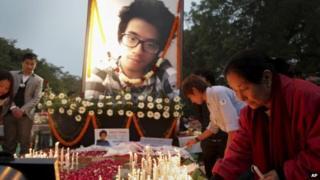 Supporters of Nido Tania, a 20-year-old university student, light candles at Jantar Mantar in New Delhi, India Saturday, Feb. 15, 2014