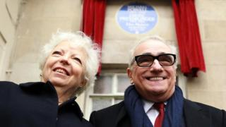 Thelma Schoonmaker and Martin Scorsese beneath Powell and Pressburger plaque