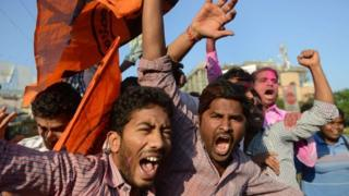 Indian supporters of Telangana state shout slogans as they celebrate the planned creation of Telangana state in Hyderabad on February 18, 2014. Indian