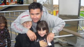 San Francisco Giants baseball fan Bryan Stow and his two children in April 2011 before the attack