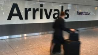 A passenger arrives in international arrivals at Heathrow Airport