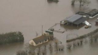 Flooded stables and house at Moorland, Somerset