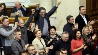 Opposition memebers, including leader Vitaly Klitschko (top R) celebrate as parliament votes to remove President Viktor Yanukovych