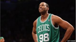 Jason Collins in a Boston Celtics shirt, playing against the Brooklyn Nets on 15 November 2012