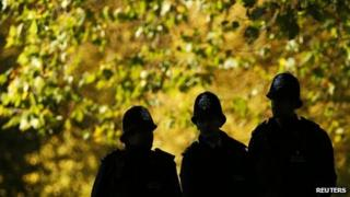 Silhouette of police officers