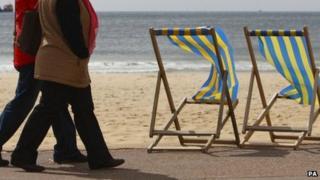 Couple walking on Bournemouth beach