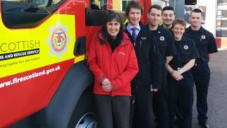 Melanie Smith and firefighters