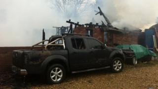 Bungalow and vehicle damaged by fire