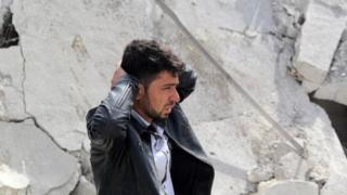 A man reacts to the destruction of his home in the Syrian city of Aleppo on 22 February, 2014