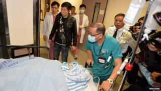 Former Ming Pao chief editor Kevin Lau is taken to an operation room in a hospital in Hong Kong, 26 February 2014
