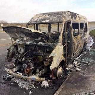 Burnt-out minibus on the A55 on Anglesey