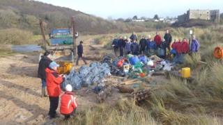 Volunteers with their haul of beach litter