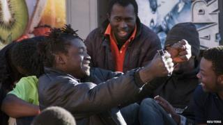 Migrants celebrating after getting into Melilla, 28 Feb 14