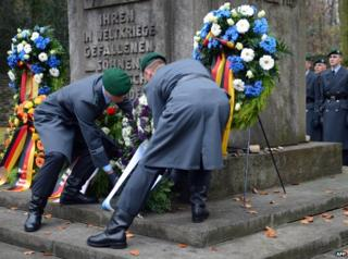 Soldiers lay down a wreath at the Jewish Cemetery in Berlin Weissensee, on November 18, 2012.