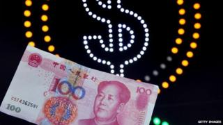 A 100-yuan banknote against the background of a US dollar sign