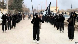 Undated image posted on a militant website shows rebel fighters from the Islamic State of Iraq and the Levant (Isis) marching in Raqqa, Syria