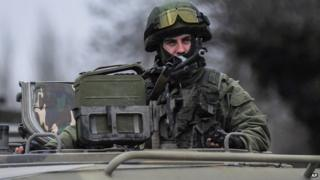 Uniformed man in military vehicle in Balaklava, Crimea, on 1 March 2014