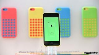 Apple iphone5c with phones in background