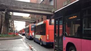 Buses queue up near the bus station