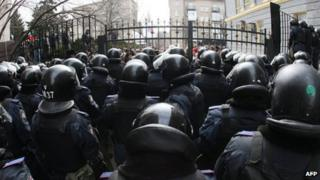 Riot policemen stand guard in front of the regional administration in Donetsk, Ukraine, on 3 March 2014