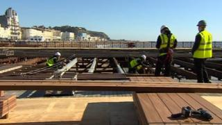 Decking being laid at Hastings Pier