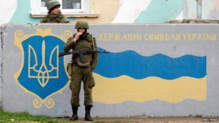 Russian servicemen stand guard at the Belbek Sevastopol International Airport in the Crimea