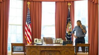 President Obama talks on the phone
