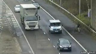 CCTV shows the cyclist on the hard shoulder preparing to cross the carriageway