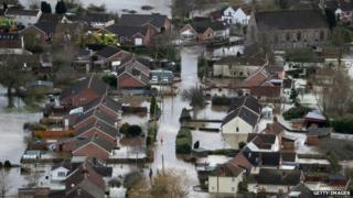 Water surrounds flooded properties in the village of Moorland