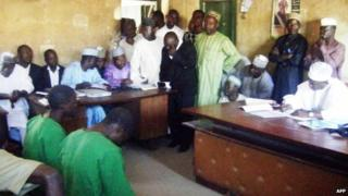Two men appear before an Islamic court in Bauchi, Nigeria (22 January 2014)