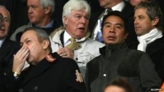 "Carson Yeung looks on alongside David Sullivan (L) from the director""s box during the Barclays Premier League match between Birmingham City and Wigan Athletic at St. Andrew""s Stadium on 27/10/07 in Birmingham"